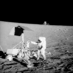 Apollo 12 Commander Pete Conrad examines Surveyor 3's TV camera prior to detaching it<br >original 6515x6515 image at https://www.nasa.gov/sites/default/files/as12-48-7134_0.jpg 19691120_Apollo_12_visits_Surveyor_3_as12-48-7134_0-256.jpg